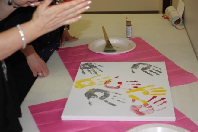 prayer canvas of handprints